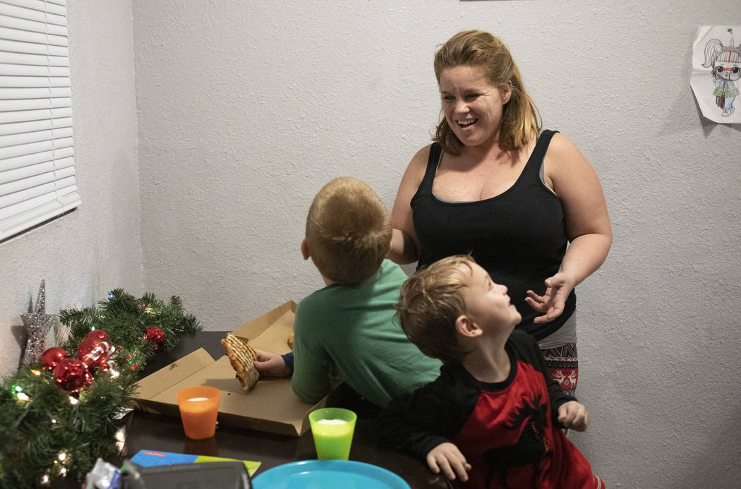 Joan Williams laughs with her sons Chase Huebner, 6, left, and John Huebner, 2, right, as they ...