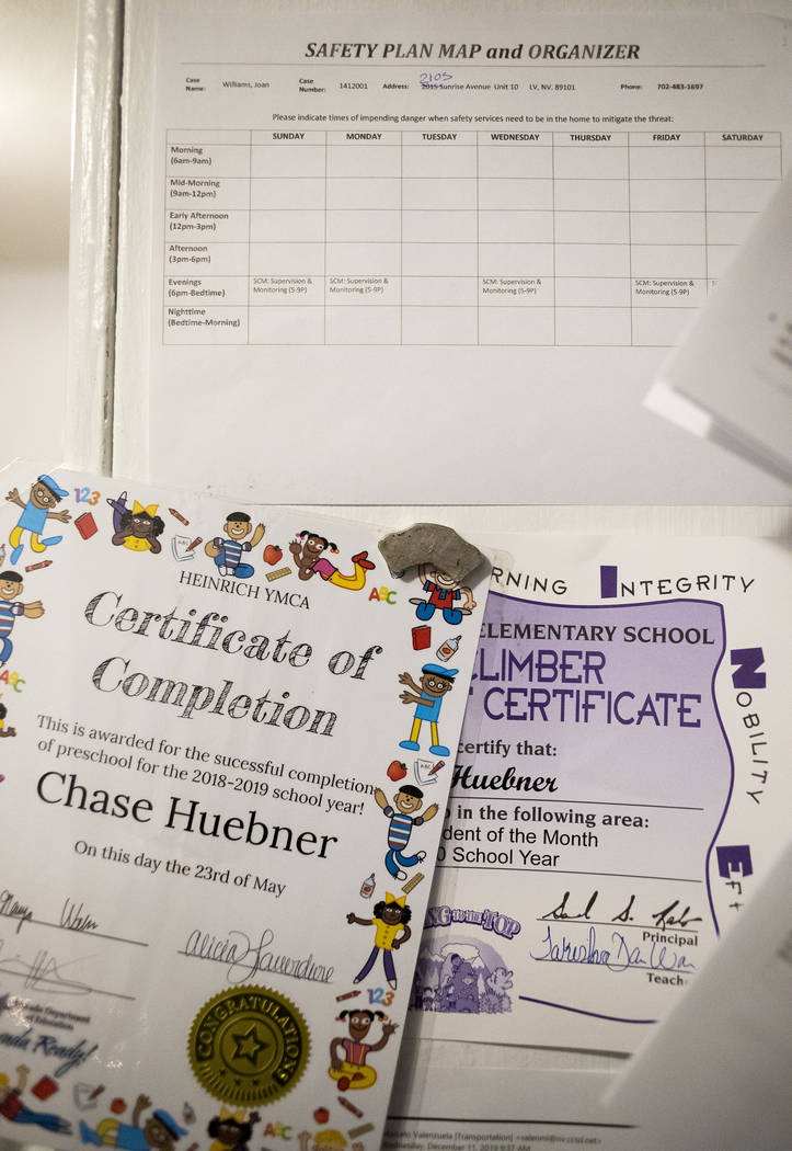 "Chase Huebner's ""Student of the Month"" awards are hung up on the wall at his mother J ..."