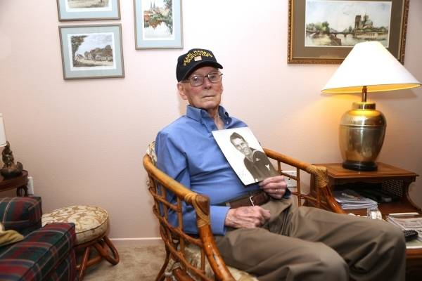 Lenoard Nielsen, a 93-year-old Pearl Harbor survivor, poses for a portrait at his home in Las V ...
