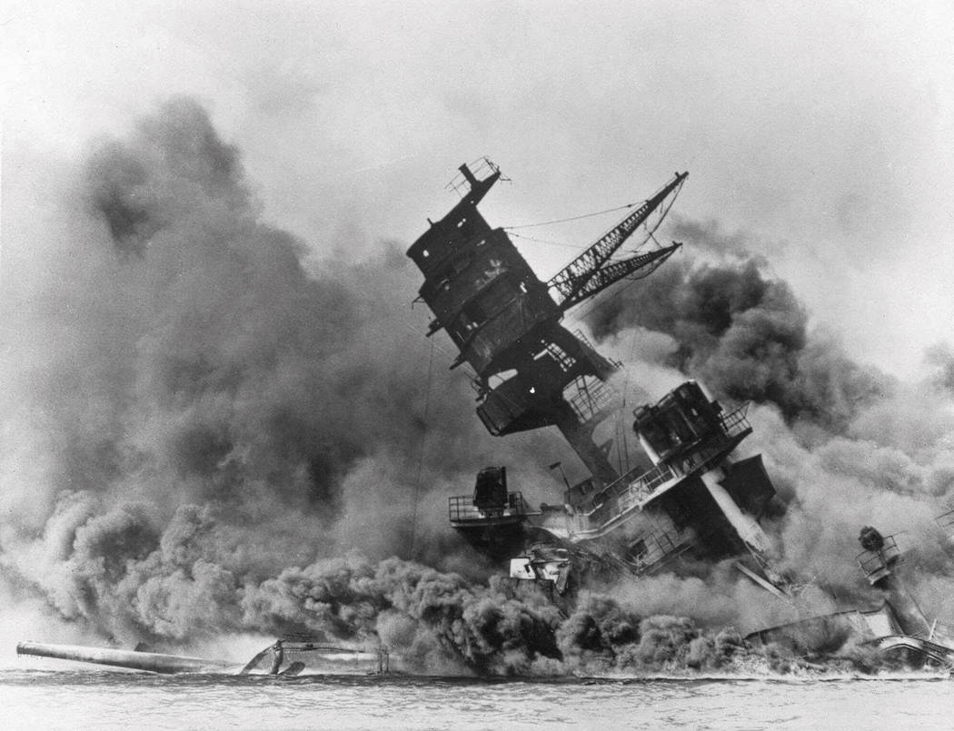 In this Dec. 7, 1941 file photo, smoke rises from the battleship USS Arizona as it sinks during ...