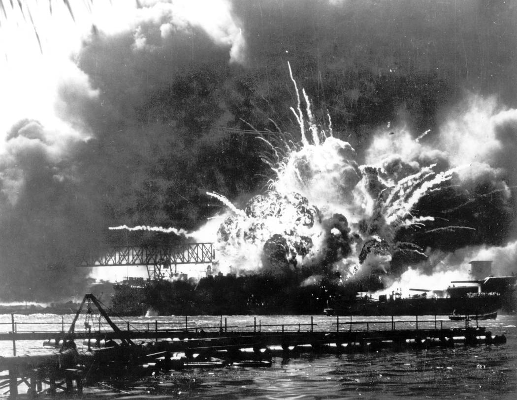In this Dec. 7, 1941 file photo provided by the U.S. Navy, the destroyer USS Shaw explodes afte ...