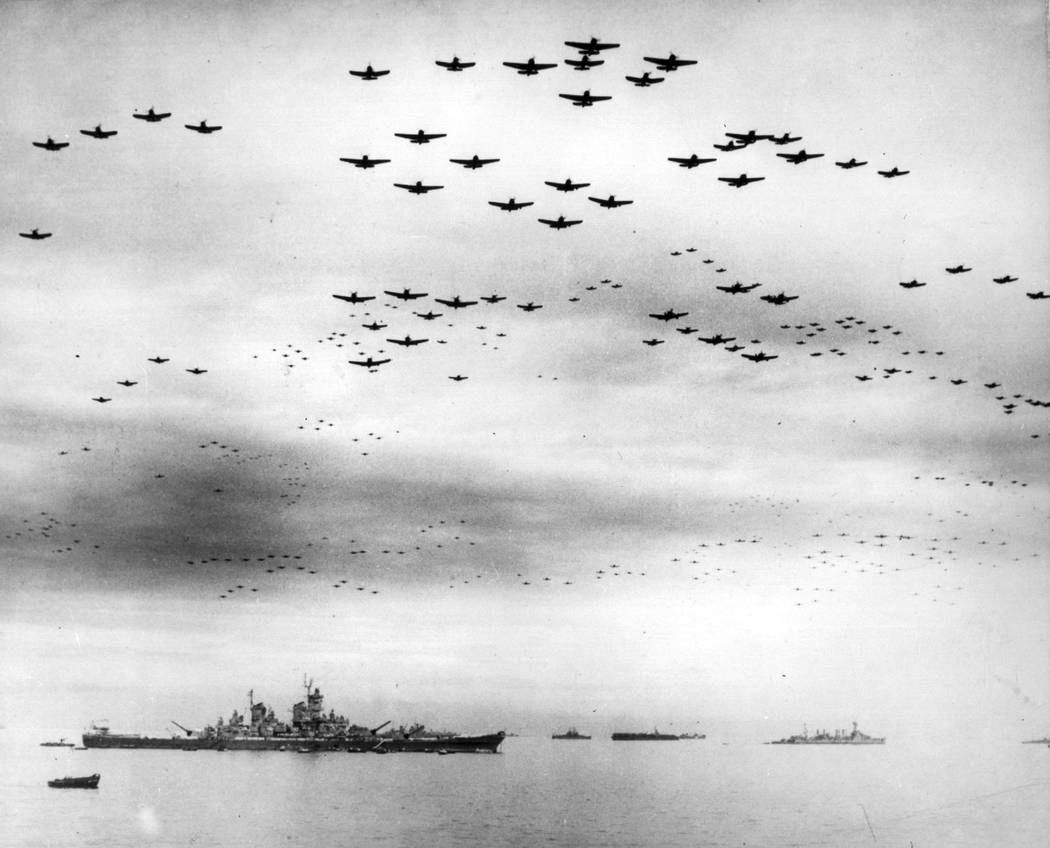 FILE - In this Sept. 2, 1945 file image provided by the U.S. Navy, F4U and F6F fighter planes f ...