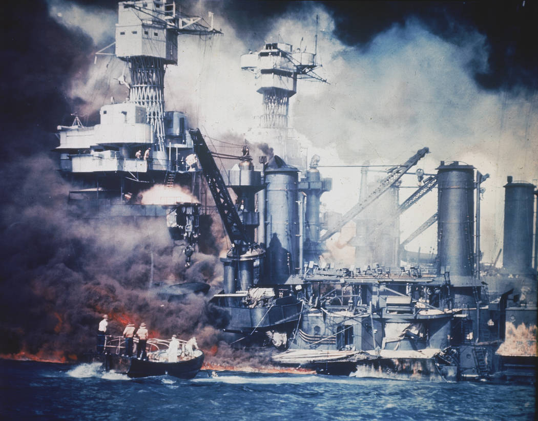 ** FILE ** In this Dec. 7, 1941 file photo, a small boat rescues a USS West Virginia crew memb ...
