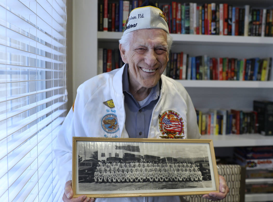 U.S. Army Air Corps veteran Edward Hall, a 95-year-old survivor of Pearl Harbor, poses for a ph ...