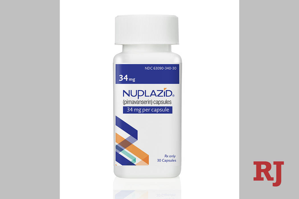 This undated photo provided by Acadia Pharmaceuticals Inc. shows a bottle of Nuplazid, a drug t ...