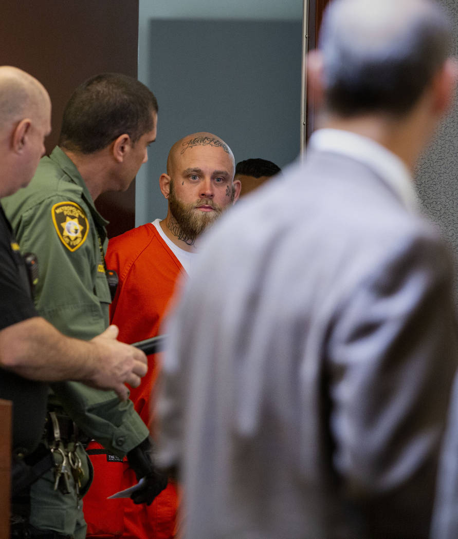 Bayzle Morgan enters the courtroom for a hearing at the Regional Justice Center in Las Vegas on ...