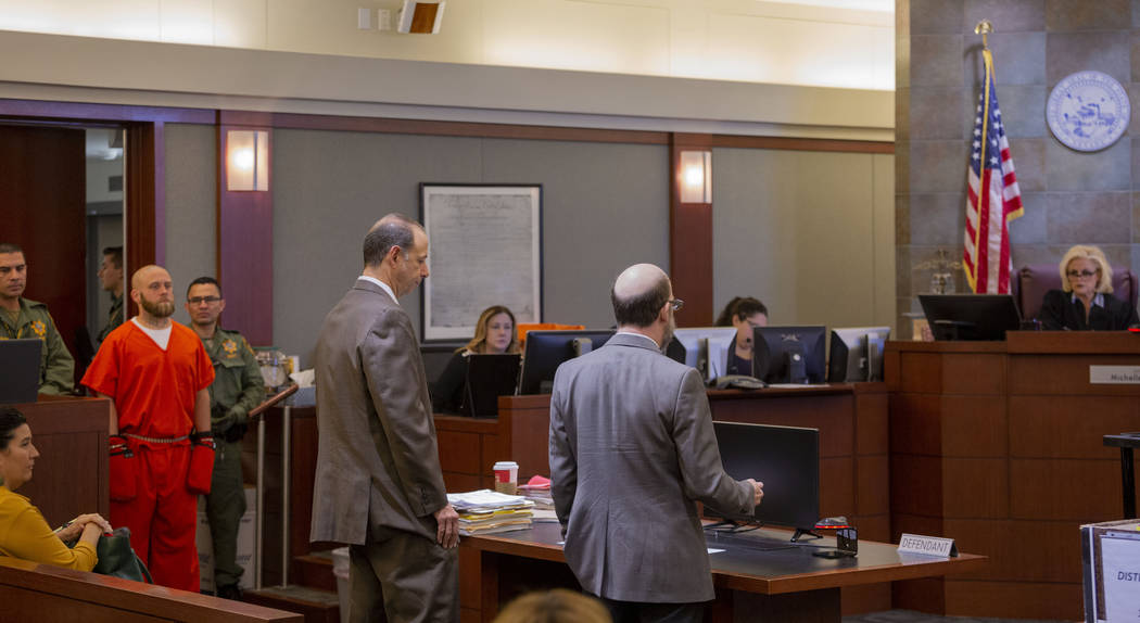 Defense attorneys Dan Bunin, left, and Dayvid Figler speak with Judge Michelle Leavitt on behal ...