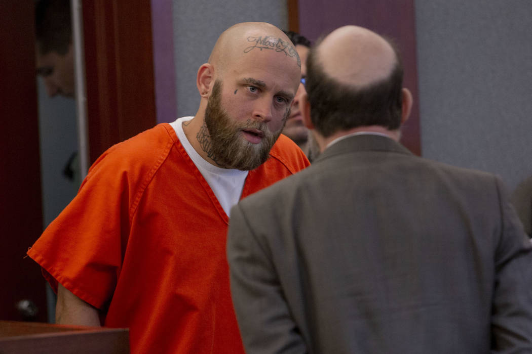 Bayzle Morgan, left, speaks with his defense attorney Dayvid Figler during a hearing at the Reg ...