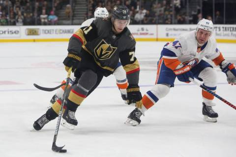 Golden Knights center William Karlsson (71) moves toward the New York Islanders goal with the p ...