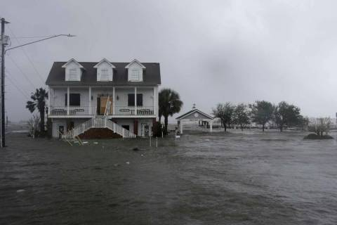 In a Sept. 14, 2018, file photo, high winds and water surround a house as Hurricane Florence hi ...