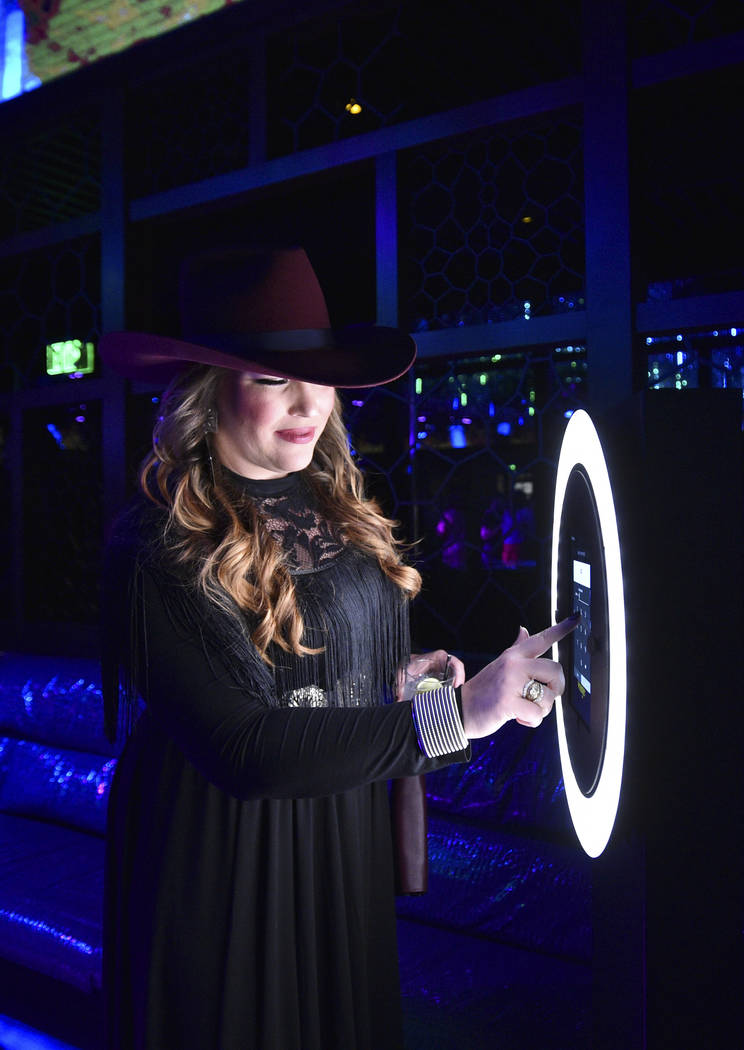 An attendee uses the selfie station during the WNFR Party With Abandon at the Ling Ling Club in ...