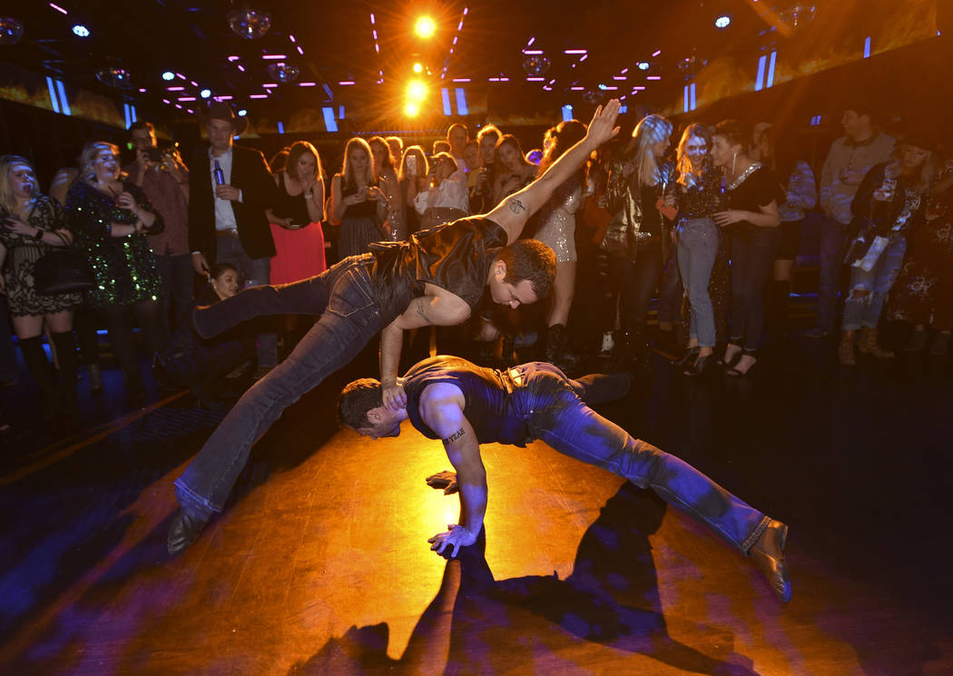 An acrobatic duo perform during the WNFR Party With Abandon at the Ling Ling Club in Hakkasan L ...
