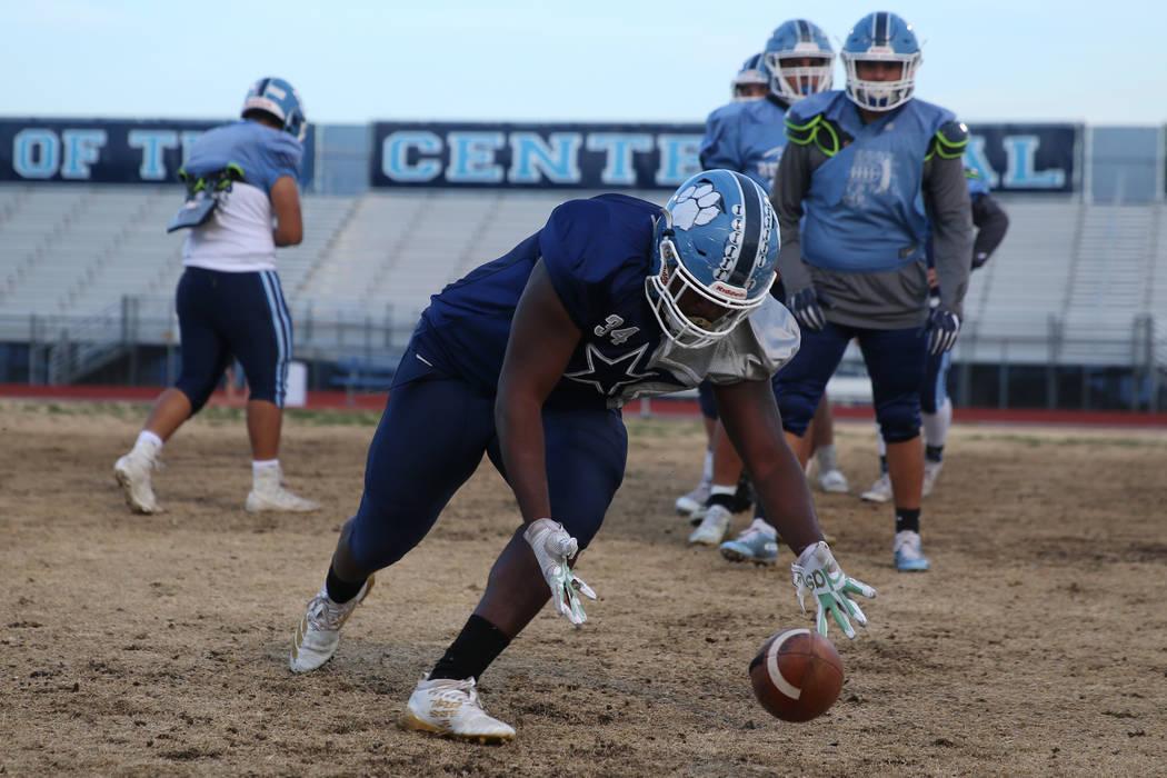 Centennial's Keaun Jackson picks up a loose ball during a team practice drill at Centennial Hig ...
