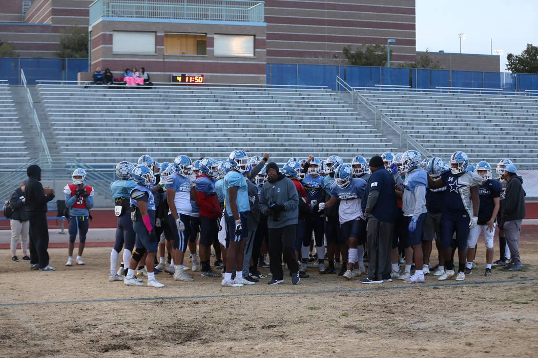 Centennial players huddle during a team practice at Centennial High School in Las Vegas, Thursd ...