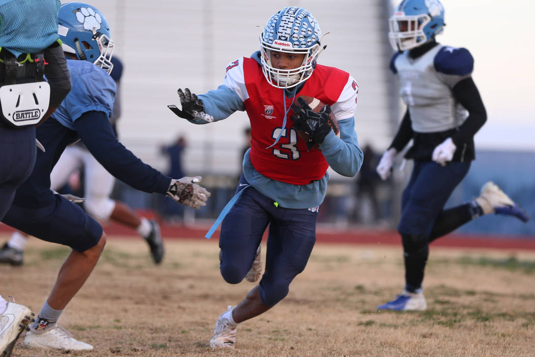 Centennial's Gerick Robinson runs the ball during a team practice at Centennial High School in ...