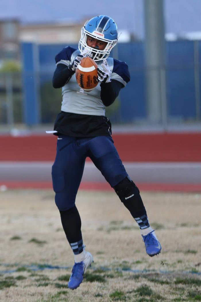 Centennial's running back Jordan Smith makes a catch during a team practice at Centennial High ...