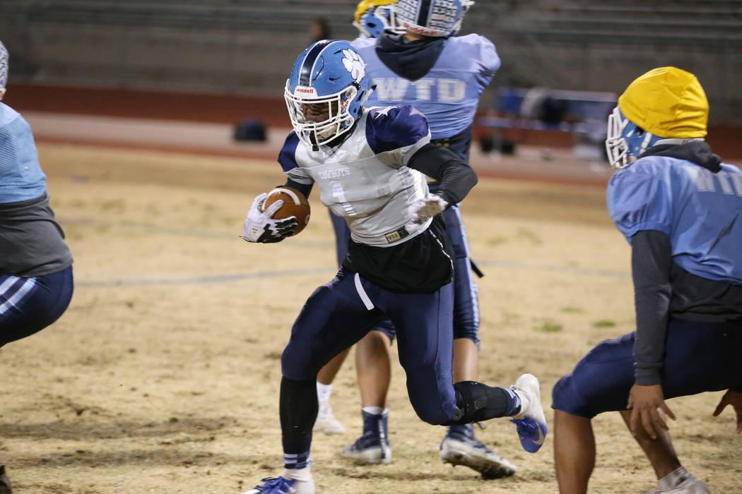 Centennial's running back Jordan Smith runs the ball during a team practice at Centennial High ...