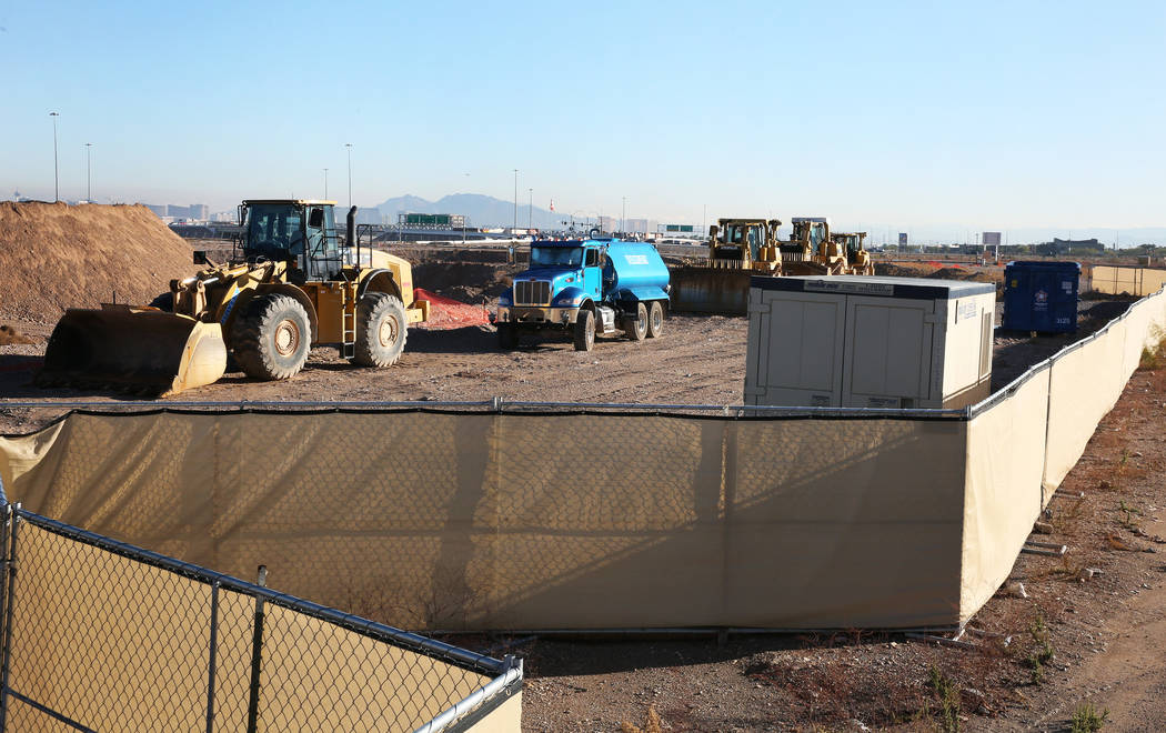 Heavy construction equipment is seen at an apartment complex project site near the Buffalo Driv ...