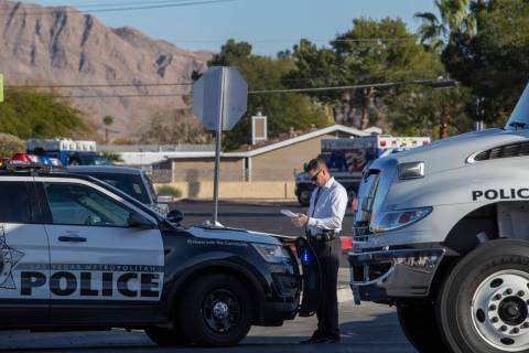 Las Vegas police respond to a barricade situation with an armed male near the 100 block of Bel ...