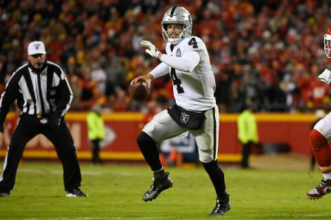 Oakland Raiders quarterback Derek Carr (4) scrambles against the Kansas City Chiefs during the ...