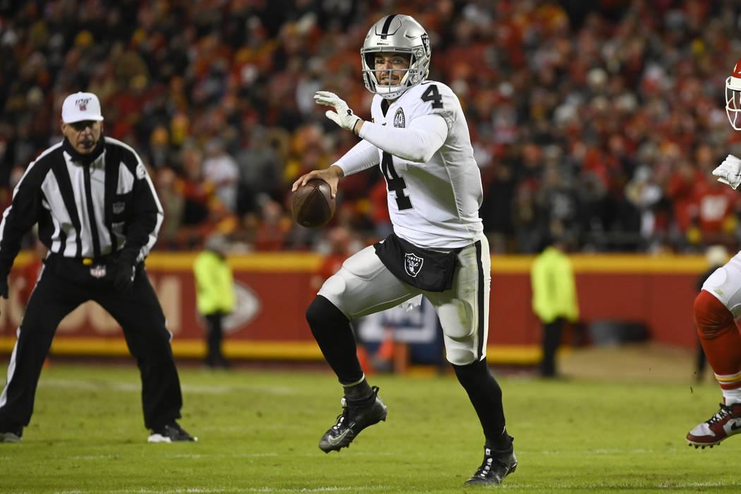Oakland Raiders quarterback Derek Carr (4) scrambles against the Kansas City Chiefs during the ...