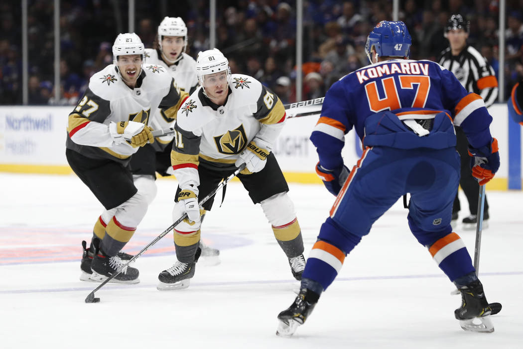 Vegas Golden Knights center Jonathan Marchessault (81) and defensemen Shea Theodore (27) and Ni ...