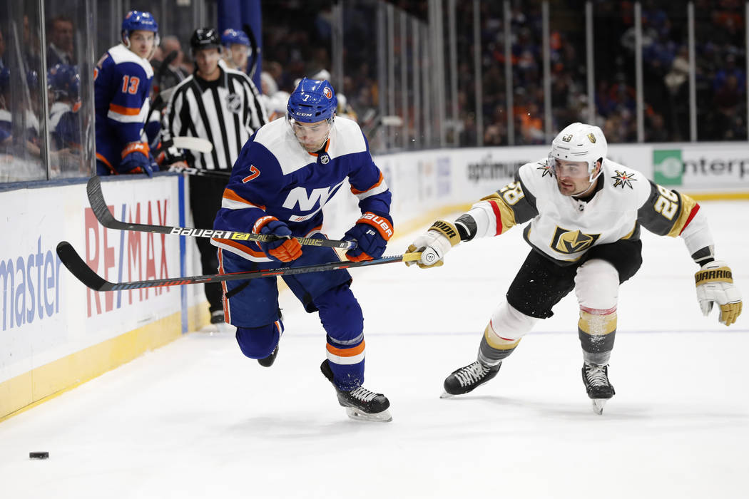 Vegas Golden Knights left wing William Carrier (28) gets his stick in front of New York Islande ...