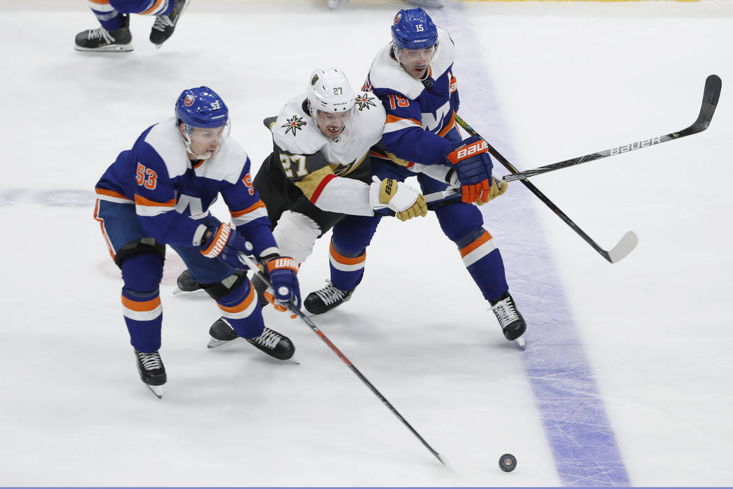 New York Islanders center Casey Cizikas (53) takes control of the puck as Vegas Golden Knights ...