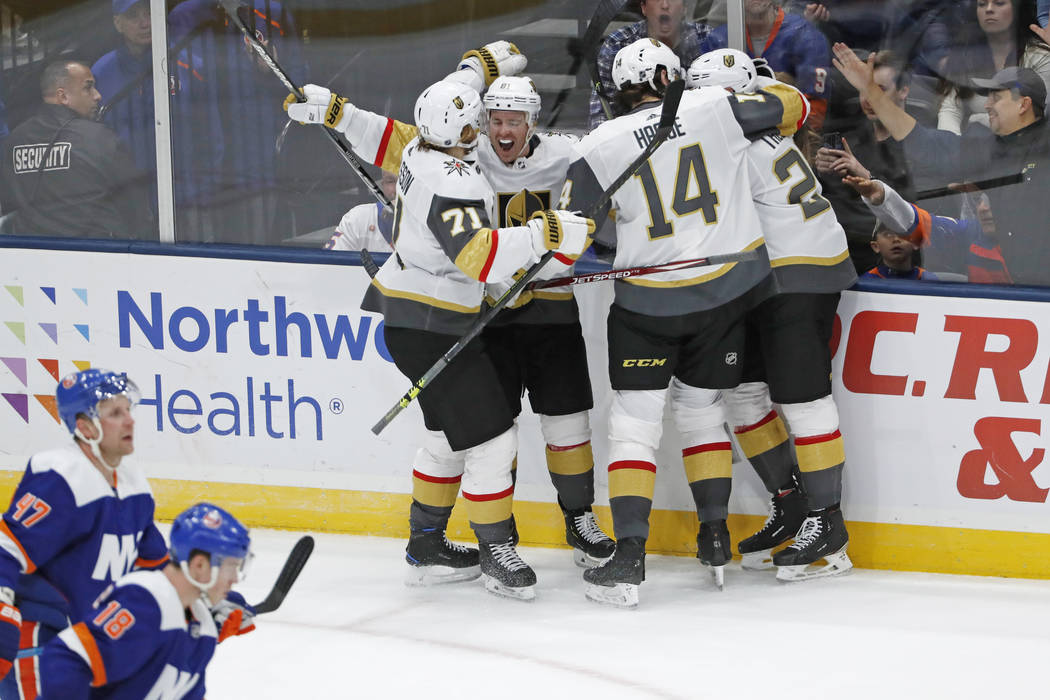 Vegas Golden Knights center Jonathan Marchessault (81) is congratulated by teammates after he s ...