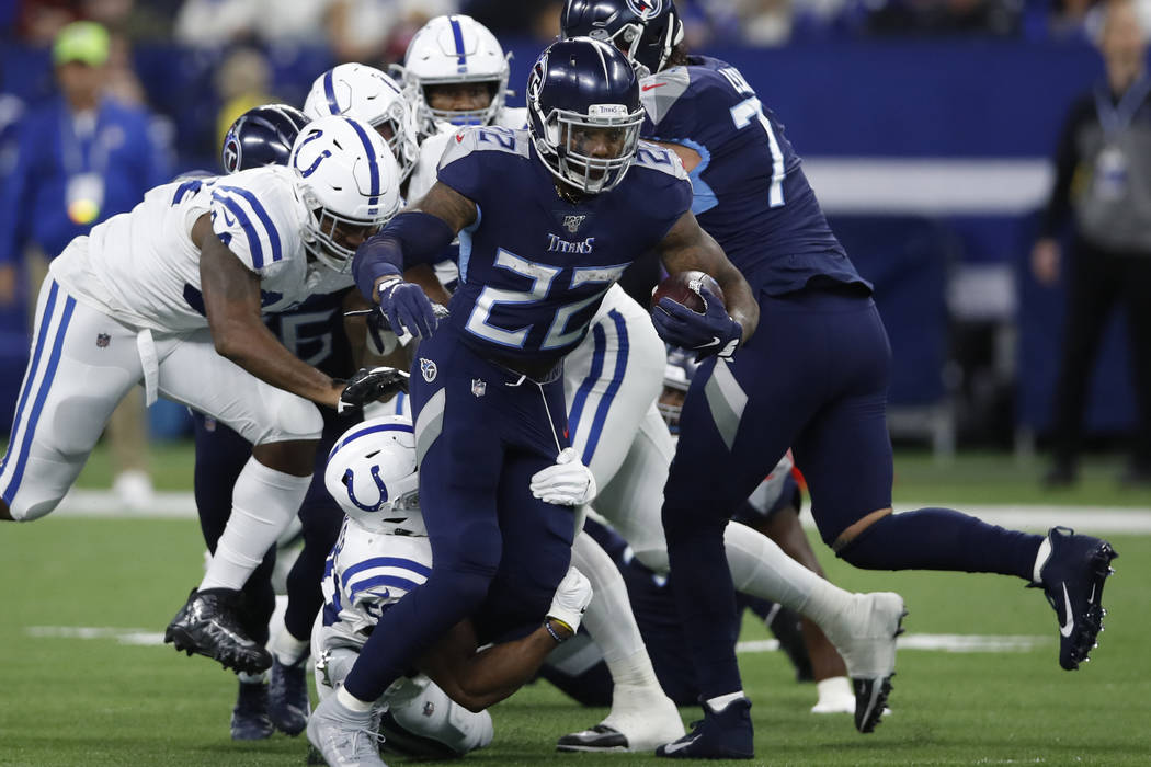 Tennessee Titans running back Derrick Henry (22) runs the ball against the Indianapolis Colts d ...