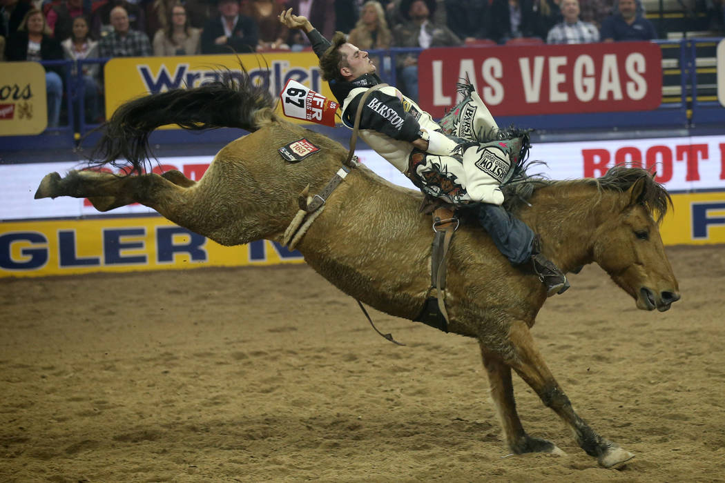 Austin Foss of Terrebonne, Ore. rides Painted River to a score of 86 in the Bareback Riding com ...