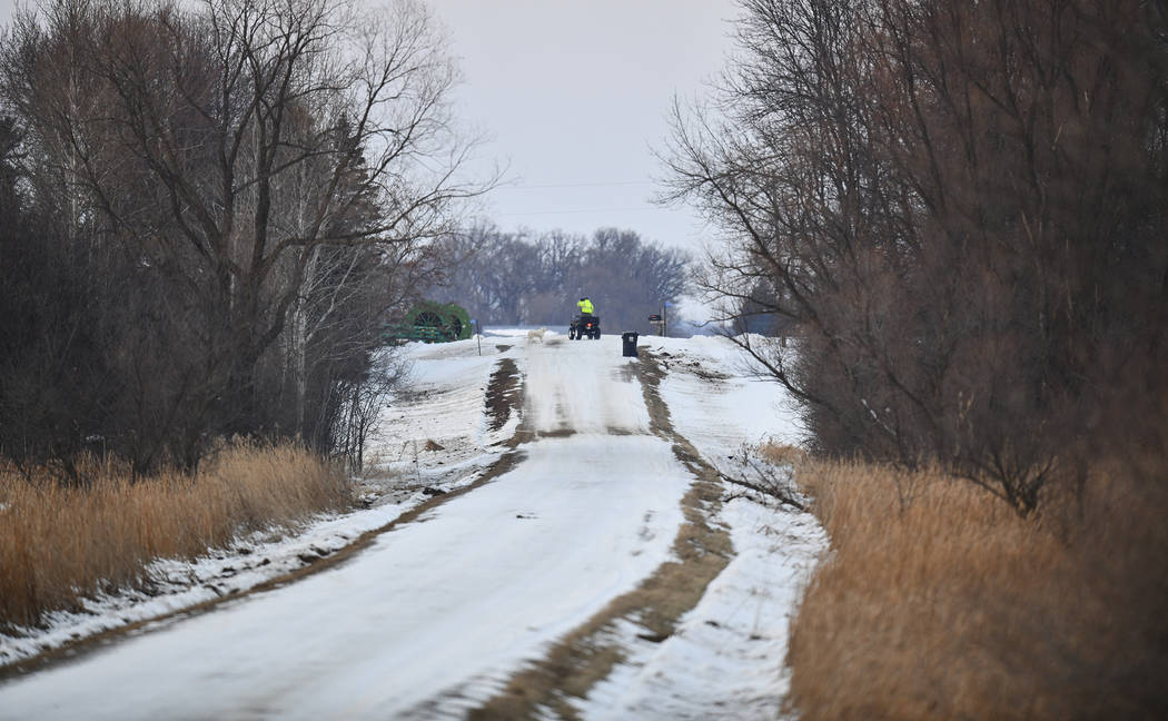 A rescue worker rides an ATV near the scene of a reported helicopter crash Thursday, Dec. 5, 20 ...
