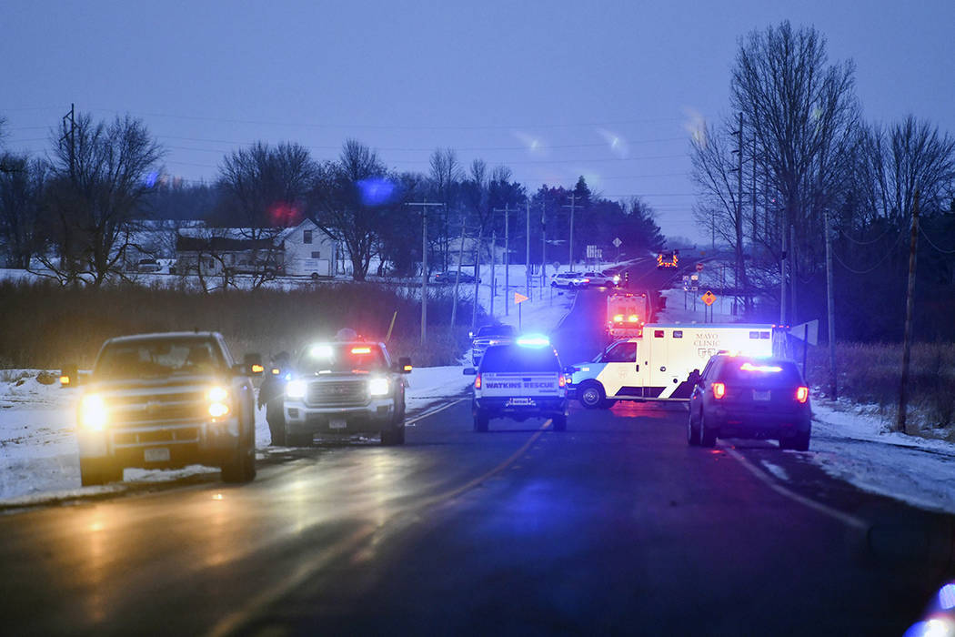 Emergency vehicles line the road near the scene of a helicopter crash Thursday, Dec. 5, 2019, n ...