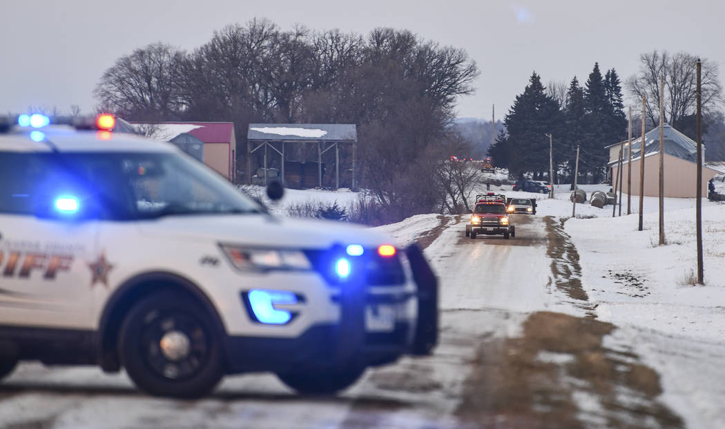 Emergency vehicles gather near the scene of a reported helicopter crash Thursday, Dec. 5, 2019, ...