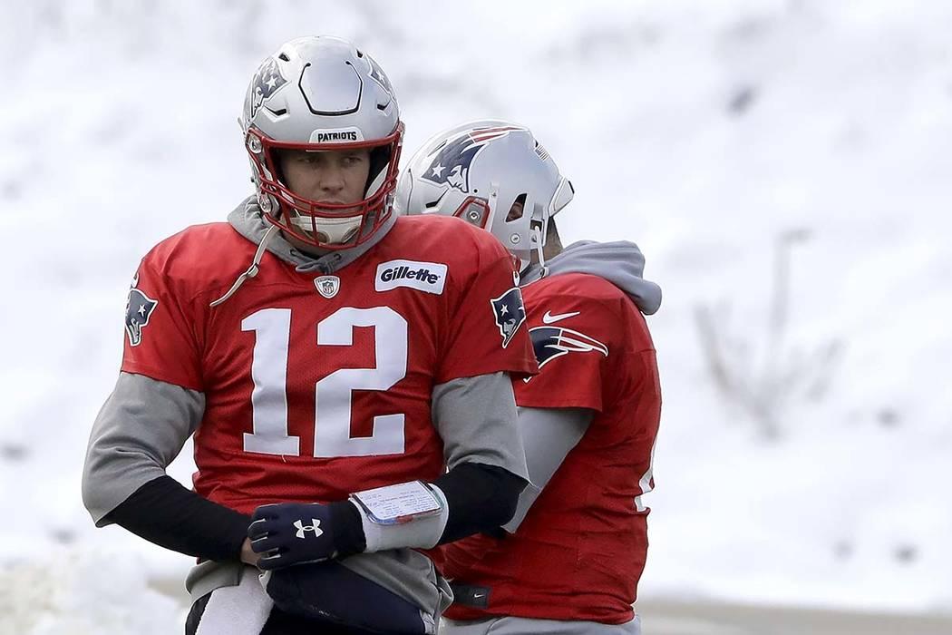 New England Patriots quarterback Tom Brady (12) warms up during an NFL football practice, Wedne ...