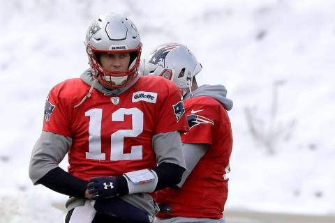 New England Patriots quarterback Tom Brady (12) warms up during an NFL football practice, Wedne ...