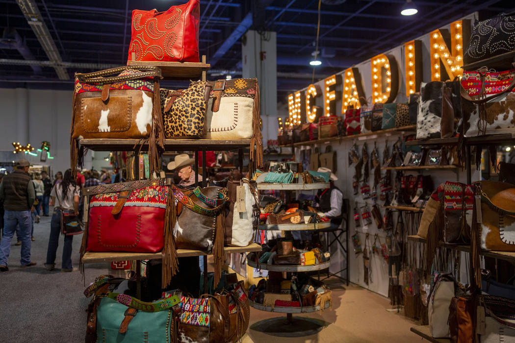 Handmade leather handbags and accessories for sale at McFadin Leather Goods booth at Cowboy Chr ...