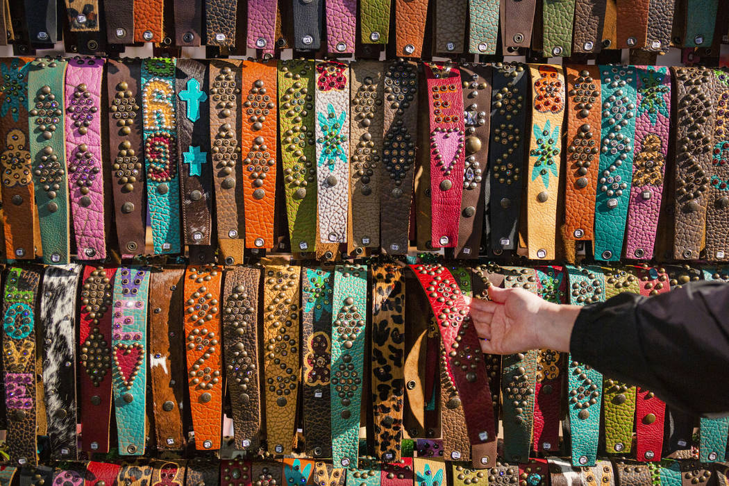 McFadin's handmade leather straps for sale at the McFadin Leather Goods booth at Cowboy Christ ...