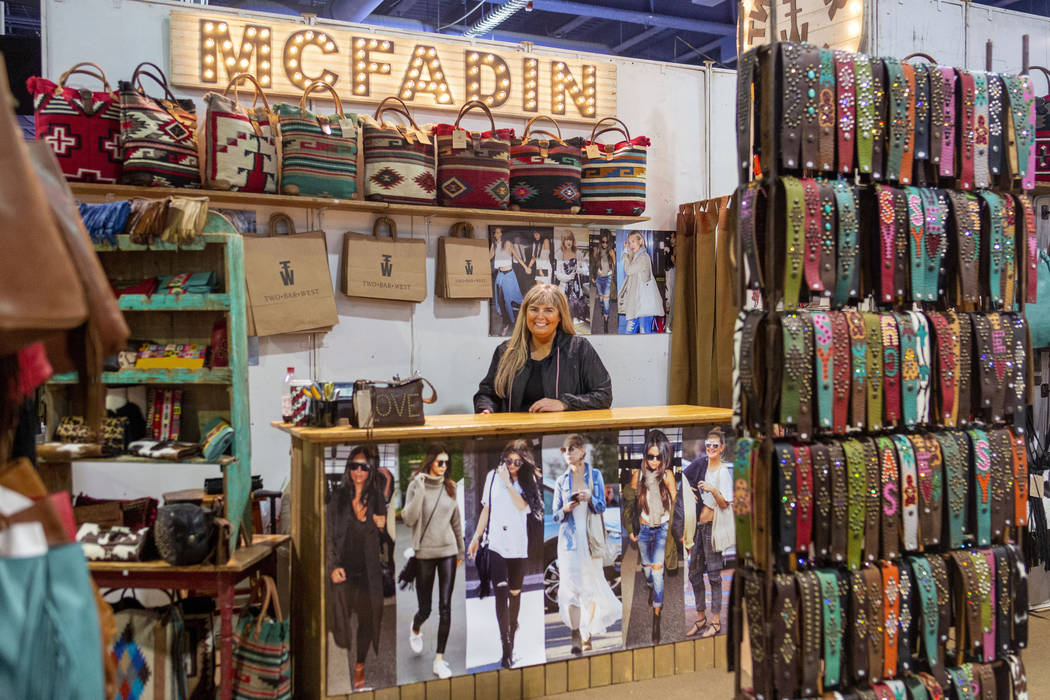 Owner of McFadin Leather Goods Laurie McFadin of Sabinal, Texas, works her booth at Cowboy Chri ...