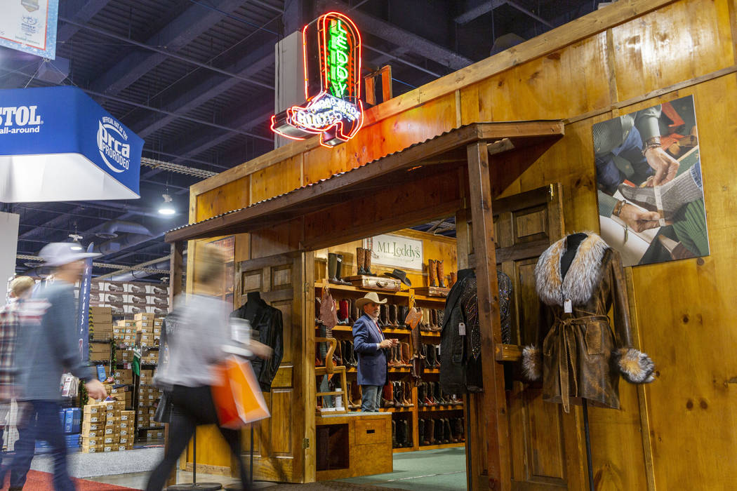 Individuals enter the M.L. Leddy's booth at Cowboy Christmas at the Las Vegas Convention Center ...