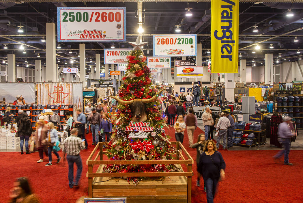 Individuals attend Cowboy Christmas at the Las Vegas Convention Center in Las Vegas on Thursday ...
