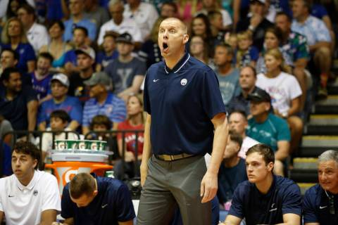 BYU head coach Mark Pope reacts to play as his team takes on Kansas during the first half of an ...
