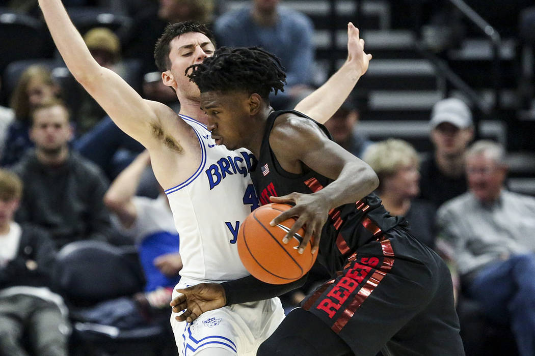 UNLV forward Donnie Tillman, right, drives into BYU guard Alex Barcello (4) during the second h ...