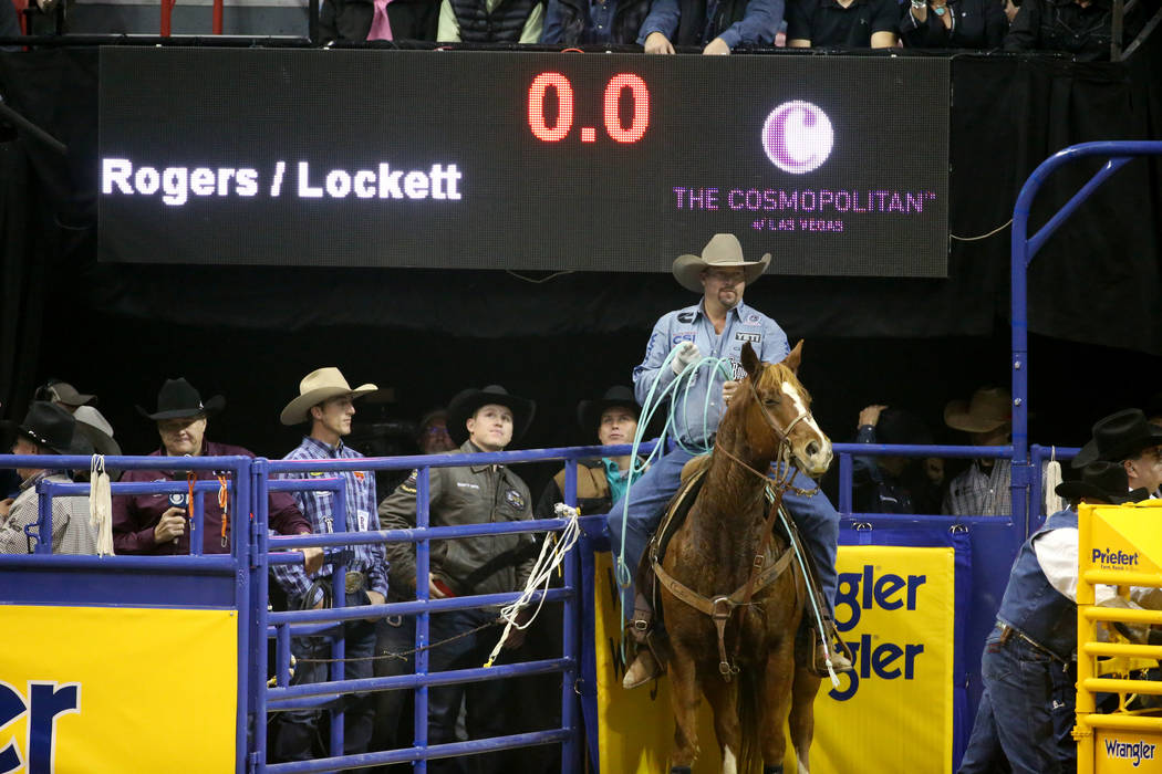 Kyle Lockett of Visalia, Calif. prepares to compete in Team Roping with Erich Rogers of Round R ...