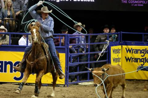 Kyle Lockett of Visalia, Calif. competes in Team Roping with Erich Rogers of Round Rock, Ariz. ...