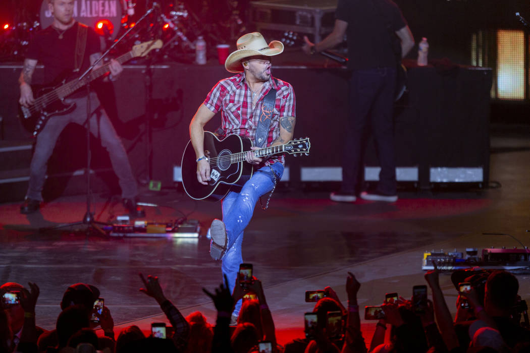 Jason Aldean performs at the Park MGM's Park Theater in Las Vegas on Friday, Dec. 6, 2019. (Eli ...