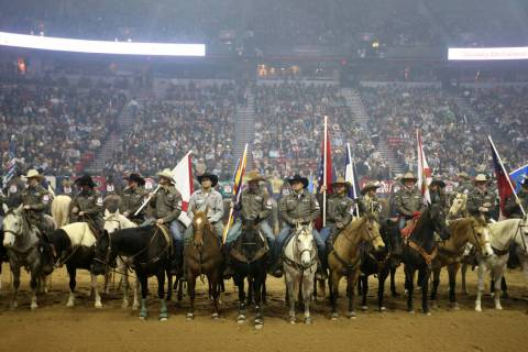 Competitors line up during the opening ceremony of the 10-day Wrangler National Finals Rodeo at ...