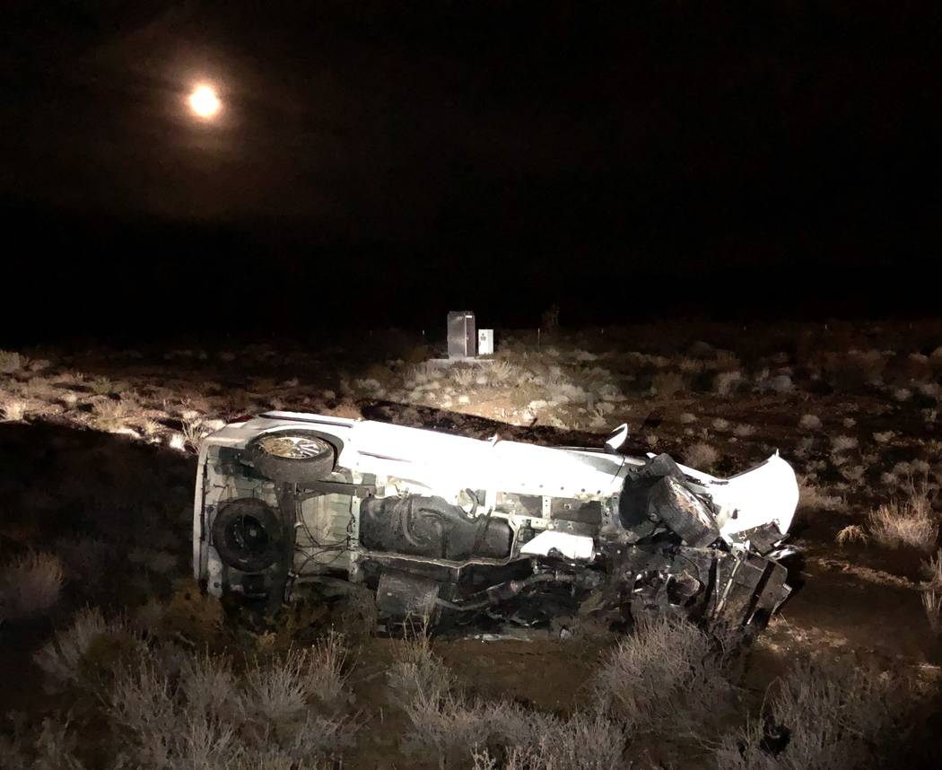 The remains of a vehicle involved in a wrong-way crash that left two people dead on Thursday, D ...