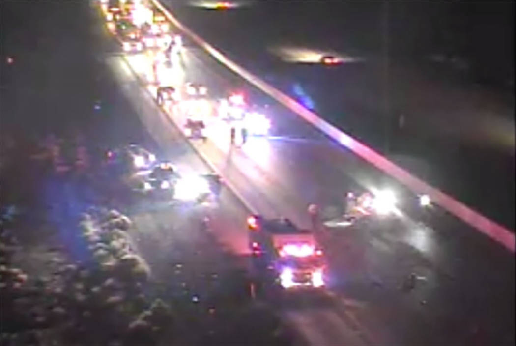 First responders work at the scene of a crash in the southbound lanes of Interstate 15 near Pri ...