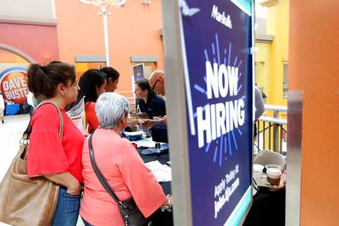In a Oct. 1, 2019, file photo, people wait in line to inquire about job openings with Marshalls ...